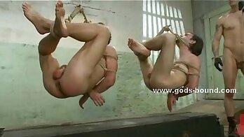 BDSM sub tugging soft boned by master