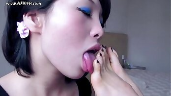 Impressive footjob by a sexy chinese girlfriend