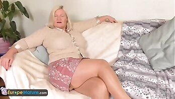 Busty tanned granny Alexe Summers gives man a firm tug