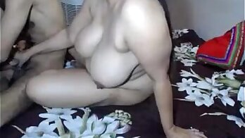 Busty mom catches her son on CAM