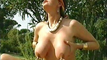 Cute old lady with pierced nipples fingering her pussy