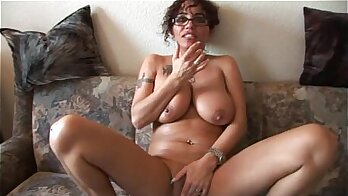 milf with a slender body is in a movie where she is fingering her pussy